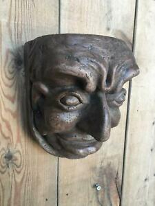 gothic style gargoyle head with oak effect wall mounted panel feature