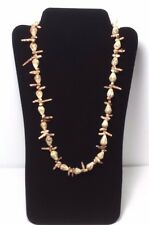 Handmade 26 Inch Tones of Tan/Brown Spiral and Oval Shell Necklace