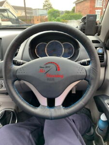 LEATHER STEERING WHEEL COVER FOR MITSUBISHI L200  LIGHT BLUE DOUBLE STITCHING