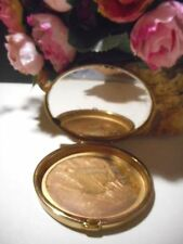 Gold tone powder compact with mirror, no name on it oval good shape..