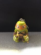 NICKELODEON 2015 TMNT MICHELANGELO KEYCHAIN WITH ONE 3D CARD PUZZLE PIECE