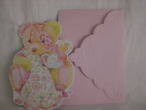 Carol's Rose Garden -  New Baby Girl - A Pink Teddy Bear on front