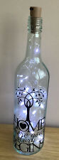 Recycled Wine Bottle With Decorated Writting On And Lights In.