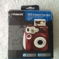 POLAROID 300 INSTANT CAMERA- RED-INC.BATTERIES + FILM 9 PHOTOS-ORIGINAL BOX-VGC