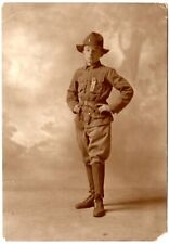 vintage sepia image Boy Scout in uniform w/ribbon,knickers,hat,knife,whistle?