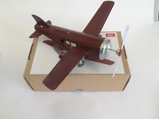 TIN TOY AIRPLANE WIND UP PLANE ROLLS & PROP PAPAYA REPRO.