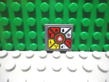 Lego 1 Dark Bluish Gray 2x2 tile with 4 studs and sticker of Ninjago signs