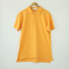 Vintage Yves Saint Laurent YSL orange polo shirt with embroidered logo.