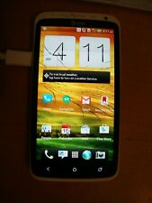HTC One X - 16GB - White,  AT&T Turns On but shattered outer Glass