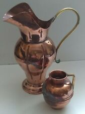 A Set Of Two Copper And Brass Vintage Jugs