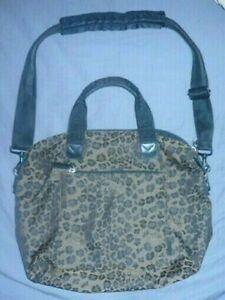 Authentic Krizia cheetah print handbag. Medium small with handles and pockets!