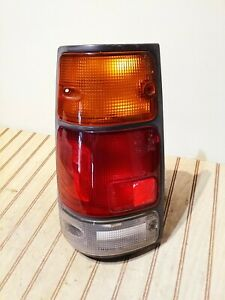 ISUZU RODEO/PASSPORT/AMIGO TAIL LIGHT DRIVER SIDE BULBS AND WIRING OEM 1991-1997