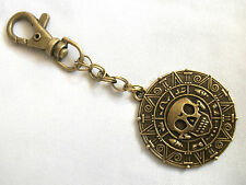 A Pirates of the Caribbean Aztec coin Medallion Skull Keyring Handbag, Bag Charm