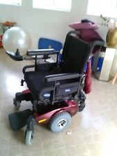 Red and black mobility rechargeable  power wheelchair