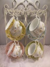 """VTG SET OF 4 CUP & SAUCERS w/A WHITE METAL WALL RACK TO HOLD ALL-17 1/2""""T X 15""""W"""