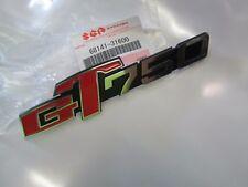 Suzuki GT750 nos side cover badge  1973-1977