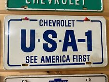 VINTAGE 1960s CHEVROLET USA-1 CHEVY BOWTIE SEE AMERICA FIRST METAL LICENSE PLATE
