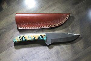 Sleek Damascus knife with multi colored ceramic handle & leather sheath