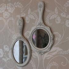 Espejos decorativos crema para el dormitorio