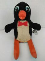 Vintage black and white penguin riding skis wind-up toy works