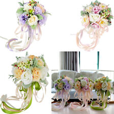 Vibrant Wedding Bride Holding Bouquet Roses with Pearl Ribbon Flowers