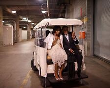 President Barack Obama and Michelle ride in golf cart Inaugural Ball Photo Print