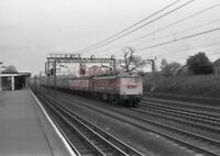 PHOTO  NO.86 2?5 PASSING CARPENDERS PARK STATION WITH THE NINE COACH 6.42AM CARL