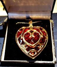 PENDANT - lovely red heart encaged in 24ct gold plated stunning- large piece.