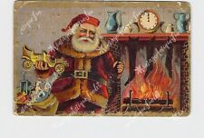 PPC POSTCARD CHRISTMAS SANTA FILLING STOCKINGS NEXT TO FIRE MANTLE CLOCK EMBOSSE
