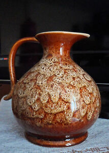 LARGE BROWN/WHITE MOTTLED JUG. NEW DEVON POTTERY ENGLAND, 14 CM TALL.ALL GOOD
