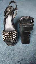Women's Heelless black wedges with metal studs, size 4.