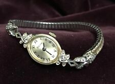 Bulova Ladies Watch Battery operated Diamond chips, in band and watch