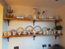 Rustic Chunky Wooden shelf with marks of age and wear and cast iron brackets