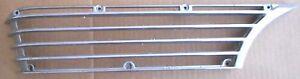 1964 64 CADILLAC DEVILLE USED LEFT FRONT SIDE MARKER BEZEL.