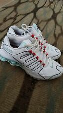 nike shox women size 8 white, teal and red. Excellent pre-owned condition