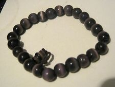 Very pretty elasticated beaded bracelet with brown opaque beads
