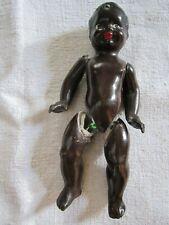 bébé poupée en porcelaine noir