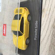 Modelauto porsche turbo geel schuco schaal 1 op43.