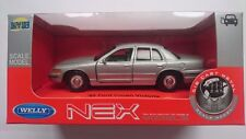 WELLY '99 FORD CROWN VICTORIA SILVER 1:34 DIE CAST METAL MODEL NEW IN BOX