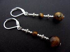 A PAIR OF PRETTY SILVER PLATED TIGERS EYE DANGLY LEVERBACK HOOK EARRINGS. NEW.