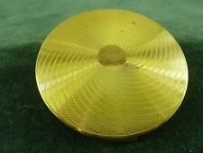 Vintage Vogue Vanities compact with gold toned with engine turned lid swirls