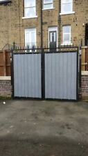wrought iron driveway gate with pvc wood cladded