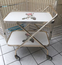 VINTAGE 1970'S TWO TIER GOLD COLOURED FOLDING FRAME HOSTESS TROLLEY.