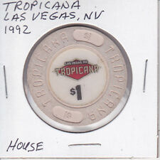 $1 CASINO CHIP TOKEN 1992 TROPICANA L. V., NV HOUSE MOLD 'LAS VEGAS NV' IN LOGO