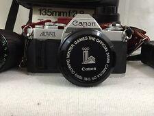 Vintage,Canon AV-1, w/4 lenses, filters, caps, case