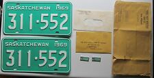 Saskatchewan 1969 License Plate PAIR & WAR AMPUTATION KEY TAGS SUPERB # 311-552