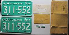 Saskatchewan 1969 License Plate PAIR & WAR AMPUTATION KEY TAGS SUPERB # 311-552