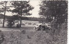 1950s Vintage retro car in the meadow nature landscape old Russian Soviet photo