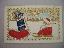 VINTAGE EMBOSSED VALENTINE'S POSTCARD BOY PULLING GIRL ON SLED IN SNOW SCENE1915