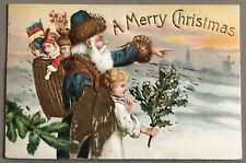 "Vintage 1909 ""A Merry Christmas"" Blue Suited Santa/Young Angel Embossed Postcard"